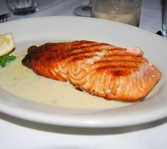 Broiled salmon steak with dry vermouth and herbs cooked in charcoal or gas grill. Super Easy and Delicious!!!