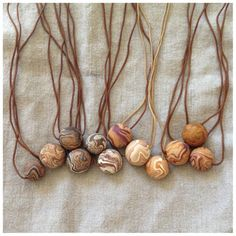 Handmade necklaces in earth tones for fall: Originally designed by two kids for charity, now a fashion phenom.