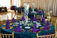 Rent tall vases for submerged orchid and floating candle - Peacock Theme Las Vegas Golf Course Wedding