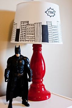 Superhero / comic / movie / vintage theme lamp & shade. Just spray paint dollar store lamp, draw on plain lampshade with sharpie... Done!