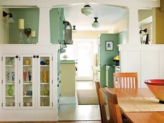 Love the Craftsman style. Not crazy about the colors, but a previous pinned listed it; All paint is from Benjamin Moore Paints (800/344-0400). The trim, bench seat, and table legs are Seashell; cabinets are Salisbury Green; walls are Light Khaki.