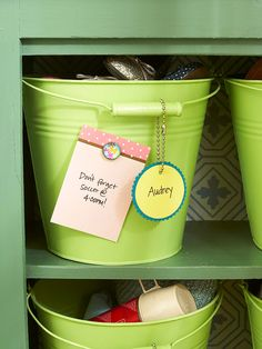 Keep an entryway organized with personalized storage buckets! More simple storage for less: http://www.bhg.com/decorating/storage/organization-basics/simple-storage-for-less/?socsrc=bhgpin061413buckets=13