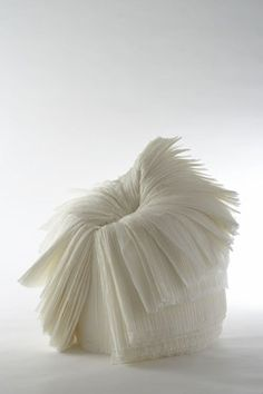 A chair made of pleated paper which appears as you peel away the layers. http://www.nendo.jp/en/works/detail.php?y=2008&t=111