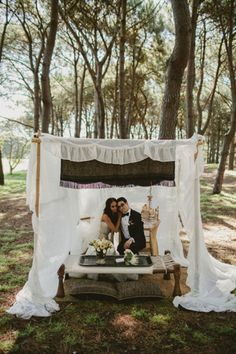 A sweetheart table in the middle of the woods?  Photo Credit: Jonas Peterson