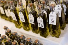 Rosemary infused olive oil escort cards and favors |  Anne + Rich Lavigne Photography