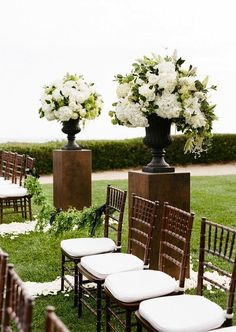 Beautiful floral arrangements transforms this outdoor wedding setting into a more formal look!