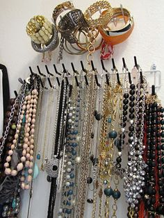 Tie rack as necklace holder..I bought one of these and hung it in my closet - it's PERFECT, I highly recommend it!!