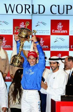 Silvestre de Sousa celebrates winning the Dubai World Cup on African Story as Hamdan bin Mohammed bin Rashid Al Maktoum, Crown Prince of Dubai (R) looks on at the Meydan Racecourse on 29.03.14 in Dubai, UAE