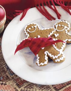 """A New England Cottage Christmas ...  Bake only if you have the time to truly enjoy it. Dress up homemade or store-bought gingerbread men with pieces of taffeta ribbon or frosting """"rickrack"""" to make them even more appealing."""