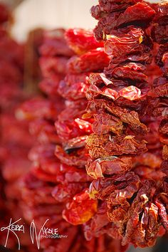 """Hang Me Out to Dry"" - Sun-dried tomatoes hang at a market stand on the island of Tinos in Greece."