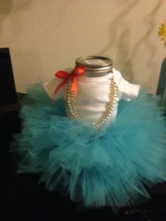 Baby Ballerina  Cover a mason Jar with onesie and tulle covered elastic for a mini tutu ! It took me 45 minutes but served as a centerpiece and gift. The elastic allows it to grow as the baby grows!