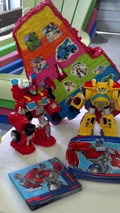 Use the Rescue Bots toys as decor...Transformer plates & napkins work well since there are no current Rescue Bot party supplies.... and decorate your own pinata with Rescue Bots' images.