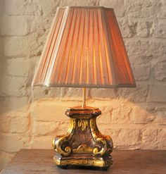 LAMPSHADE LESSON: The height of the shade itself should make up one-third to one-half the total height of the lamp. Use the lamp's total height measurement to get the appropriate proportions for the width. The width, measured at the bottom of the lampshade, should fall between one-half to three-quarters the height of the lamp.