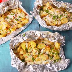 Cooking over the campfire is our favorite thing and throwing everything into a foil pack makes it so easy! These cook up so fast and make the perfect individual side dish. If you don't want to make these over the fire or grill, they also work great in the oven! Get the recipe at Delish.com. #delish #easy #recipe #campfirepotatoes #cheesypotatoes #summer #grilling #easypotatorecipe #vegetarian