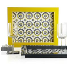 Graphic patterns in electric yellow and grey create a dynamic a look filled with energy. Z Gallerie exclusive Perspective Tray and Coasters. $9.95 - $24.95