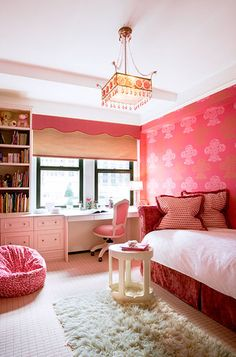 red settee daybed red pillows pink chair built-ins desk bookcases pink bean bag flokati rug roman shade pink cornice box red paint pink stencils