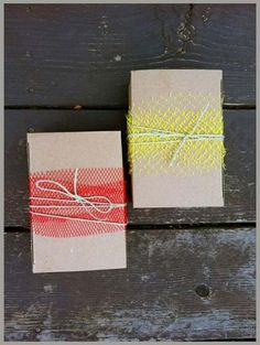These upcycled gift wrappings were made using old paper bags and some tulle , would look sweet as art too. #Upcycling #Clothes and #Ideas