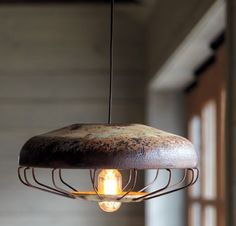 Pendant light made from a vintage chicken feeder (from Napa Style). Has a cool industrial chic quality about it...