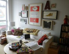 My livingroom with a salon wall with 3 of my prints: N is for novel, The Intelligent women's guide + Big brogue shoe