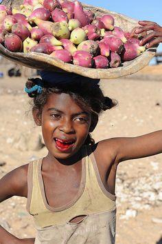 Vezo girl selling cactus fruit, Madagascar.  Photo: luca.gargano via Flickr.