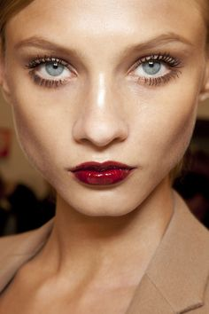 Bold lashes and glossy red lips