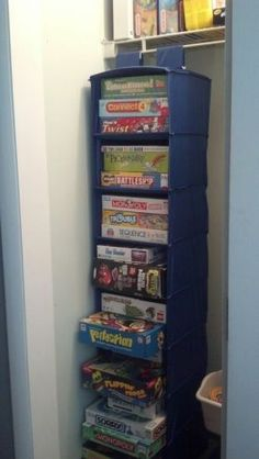 Store and organize board games in a hanging shoe organizer. Never thought of this.