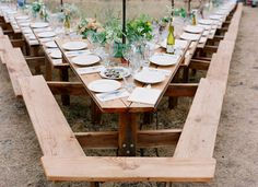 Outdoor wedding. Unusual seating arrangement picnic tables, parti