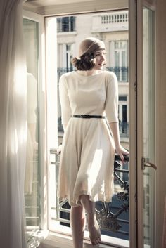 Colette Peony, in a winter white knit, with a fuller skirt.