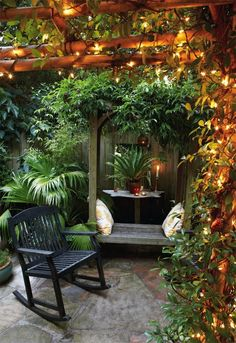 Pergola, string lights, wooden furniture and outdoor pillows