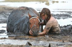 The incredible story of one woman's loyalty to her horse...she spent three hours holding its head above the tide after it got stuck in the mud on a beach in Australia. Amazing. :)