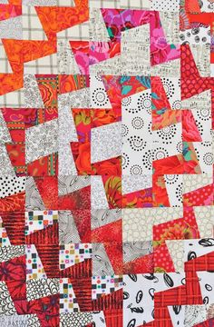 I love this fun quilt! Must put it on my 'wish' list to make. (detail of orange & white fractured quilt, from quilternity's place)
