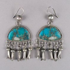 Turquoise earrings with miniature squash blossom dangles, viaShiprock Gallery