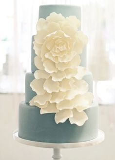 Teal and white floral cake.
