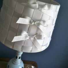 Weave ribbons around a plain lampshade and really style it up! DIY tutorial.