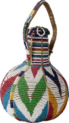 Africa | Dowry gourd from the Kamba people of Kenya | Late 19th to early 20th century | Gourd, leather and glass beads.| Beaded gourds were part of a bride's dowry and were used when serving her new husband a meal for the first time