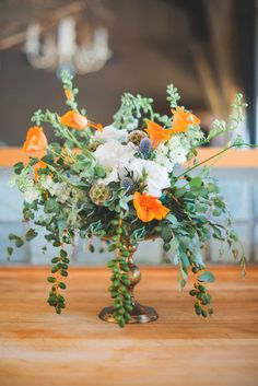 tropical floral arrangement, photo by Julie Shuford Photography http://ruffledblog.com/tropical-malibu-inspiration #weddingflowers #flowers #centerpieces