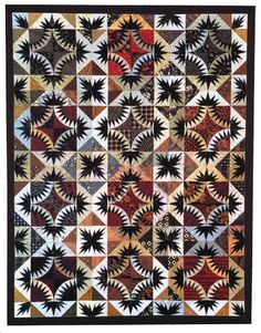 """""""McComma's Beauty"""" quilt pattern by Karen K. Stone. This dynamic spikey design, created by repeating twelve 20-inch blocks, is quickly foundation pieced because each block is broken up into four central New York Beauty blocks, with Lily, Square, Center, Corner, and Triangle sections."""