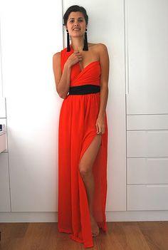 Beautiful bright orange dress, love the tasseled black earrings and matching belt.