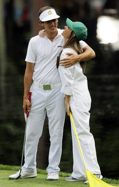 Amateur Kelly Kraft is hugged by his fiance Tia Gannon during the Par-3 competition at the Masters golf tournament Wednesday, April 4, 2012, in Augusta, Ga.