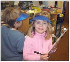 """Children grab a clipboard and don a visor to """"write the room."""" Writing-to-Read strategies differentiate learning in Katie Nelson's kindergarten. From """"Kindergarten Writing and the Common Core"""" by Nellie Edge (aka Writing-to-Read Accelerates Literacy: All Kindergartners Love to Write and Draw!)"""