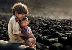 """Wow.  Kathmandu - """"This powerful image of two vulnerable children living on what seems like the very edge of survival has won Chan Kwok Hung from Hong Kong the title of Environmental Photographer of the Year 2011.  The photographer says: """"The photo was taken in Kathmandu, the capital of Nepal and is of two children who lived nearby to the junkyard with their grandmother. Every day they searched the junkyard for something useful that they can resell for money so they can buy food. If they don't find anything their grandmother blamed them seriously. Unfortunately, they had found nothing for a few days, the little boy felt very hungry. I gave them some money and a biscuit after taking this photo. But who knows who will help them afterwards."""""""