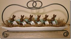 Cute and simple Easter centerpiece.  The tags on the bunnies spell Easter.