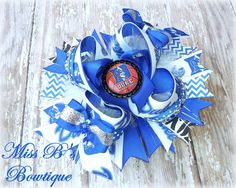 Over the Top Duke Basketball Bow   www.facebook.com/missbsbowtique05 for more info and to place your custom order today!