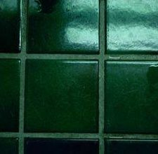 Use car wax to keep shower tile grout clean
