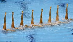 Japan performs during the team technical routine at a synchronized swimming qualification event on April 19 at the Aquatic Centre at Olympic Park in London.