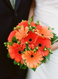 Gerber daisies with some leaves and green things added in. This is exactly what I want for my wedding bouquet someday.