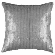 "Cotton pillow covered in silver sequins.  Product: PillowConstruction Material: CottonColor: SilverFeatures: Insert includedSequin detailsDimensions: 18"" x 18"""