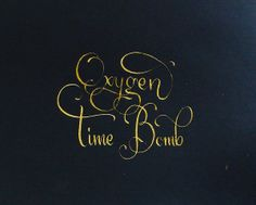 gold calligraphy on black paper.