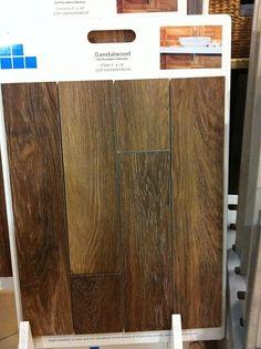 Basement flooring tile option.   Looks like wood.  Very cool.  With radiant heat underneath.