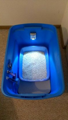 Cat litter box: Get a plastic container and cut a hole in the front. Make sure the box is a little bigger than the litter container itself so that it can trap the litter inside the box. Put a foam mat at the bottom, a few hooks on the side for items such as the scooper and attach a motion light to the back. Thats it! The smell and the litter will stay trapped in the box and you will have everything you need in one spot!